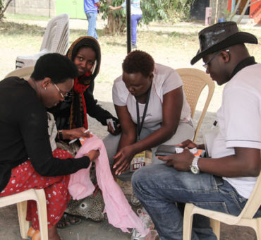 Organisers of the Imara Daima medical camp offer counselling to a patient in Imara Daima estate, Nairobi. PHOTO | FAUSTINE NGILA | NATION MEDIA GROUP